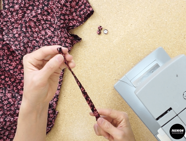 Use a loop turner to flip the strap inside out.