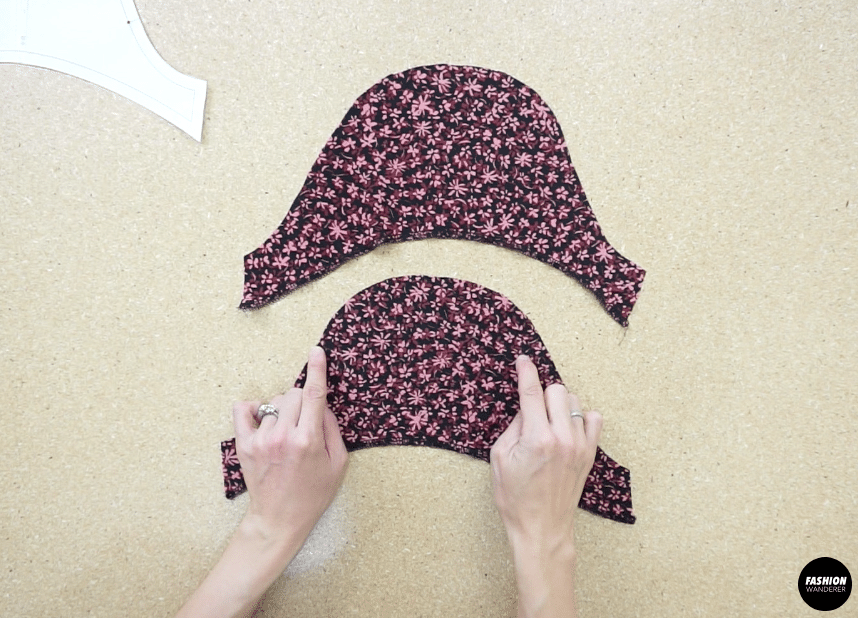 Pull on the back thread to bunch the fabric.