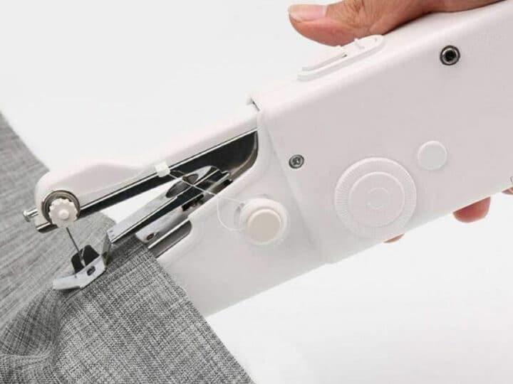handheld sewing machine to stitch fabric