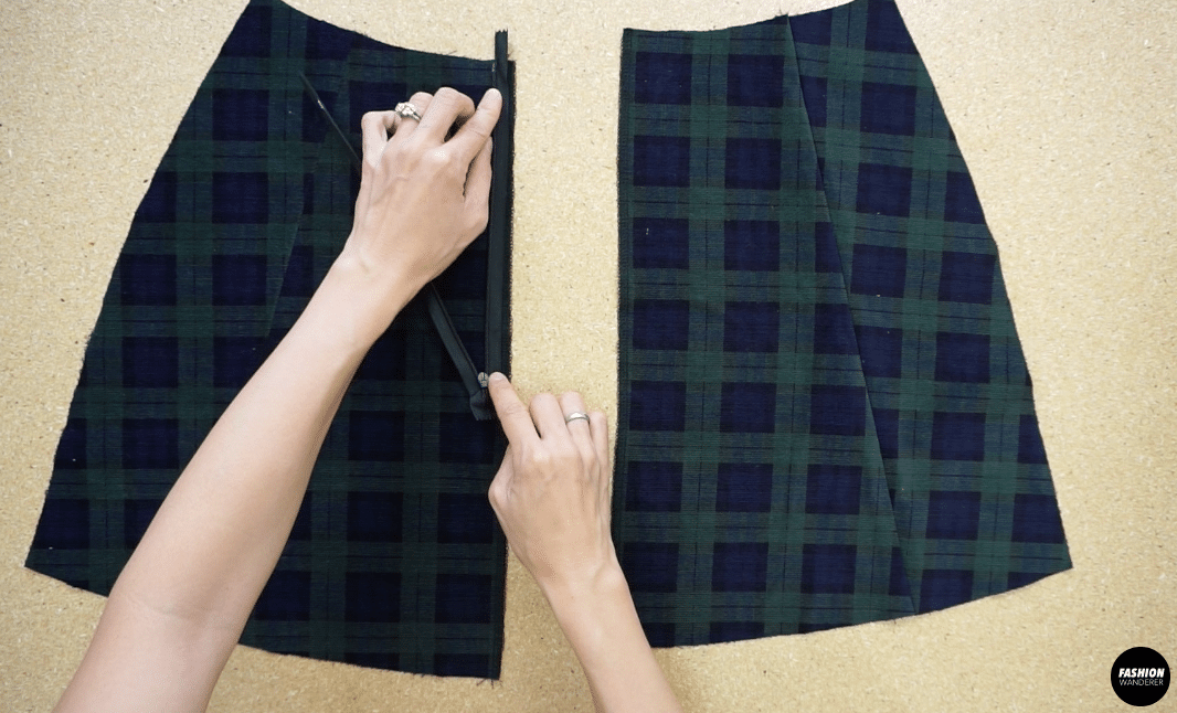 open the zipper and join the placket tape to the center back opening starting at the waistline on both sides.