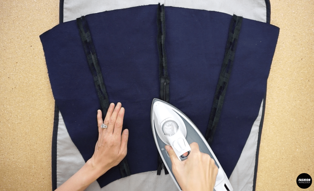 Iron the skirt pieces to create smooth and even seam lines.