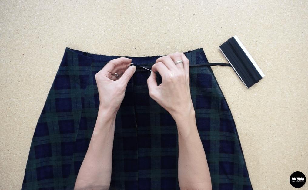 "Pin the ¼"" biased binding strip around the waistline."