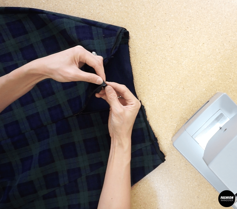 Fold the binding inside the waistline, and then topstitch to finish the waistband.