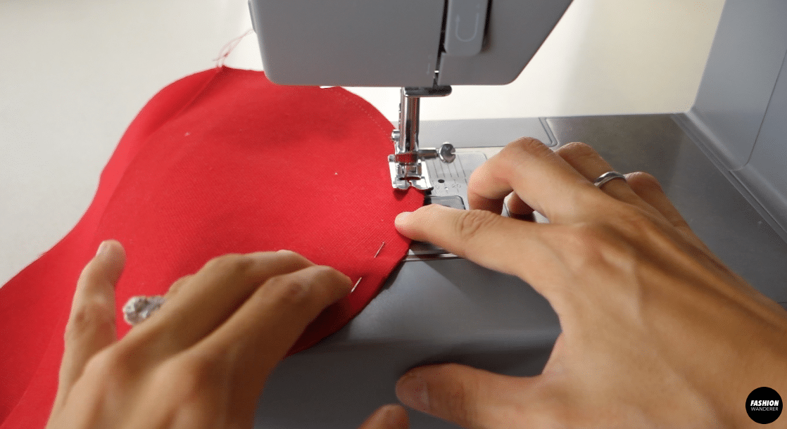 Pin to secure and sew around the edge of the side pieces.