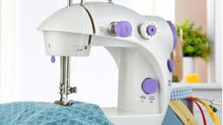 mini sewing machine sewing fabric