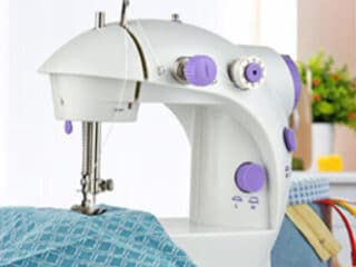 mini sewing machine sewing fabric