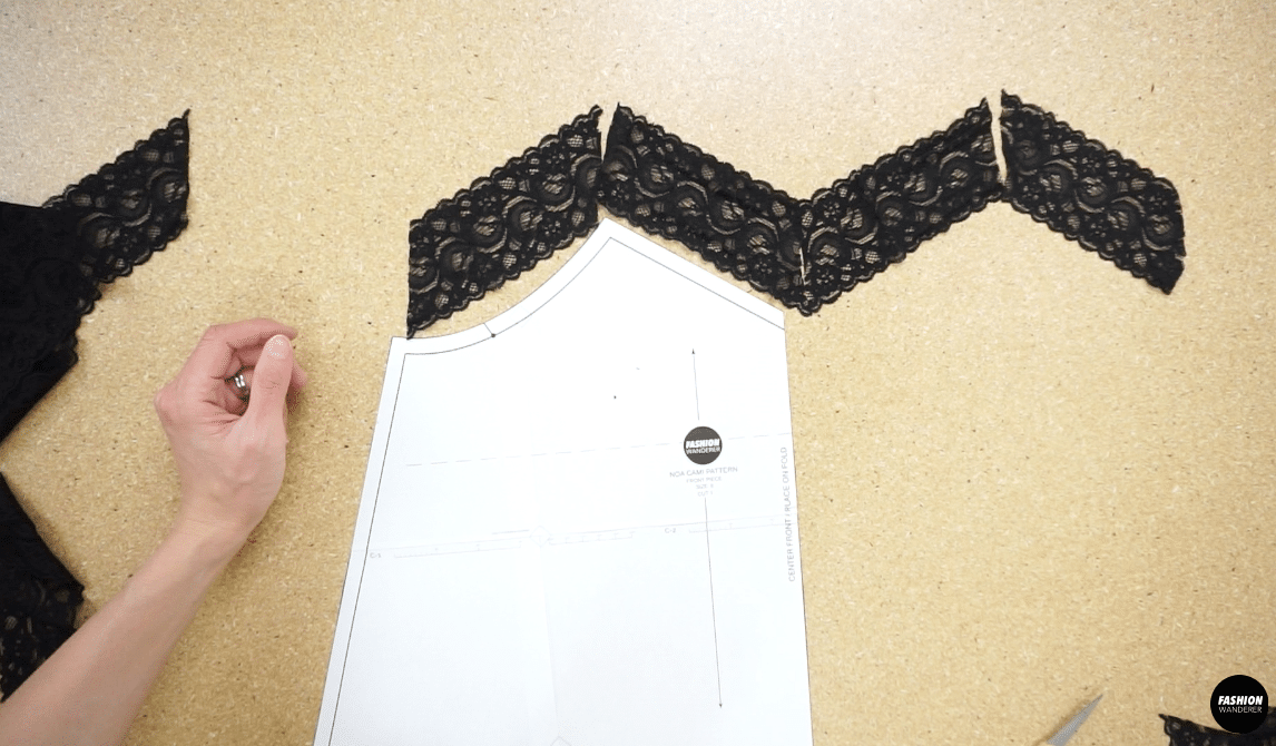 Attach lace trim pieces together to make a M shape that match the neckline.