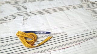 pinned sewing pattern on fabric