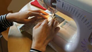 sewing fabric through the sewing machine