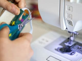 sewing elastic on the fabric using sewing machine