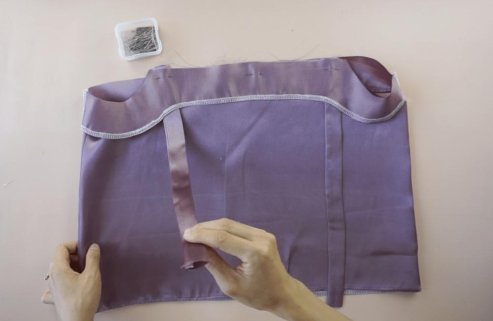 Then, slide the lining over the shoulder straps.