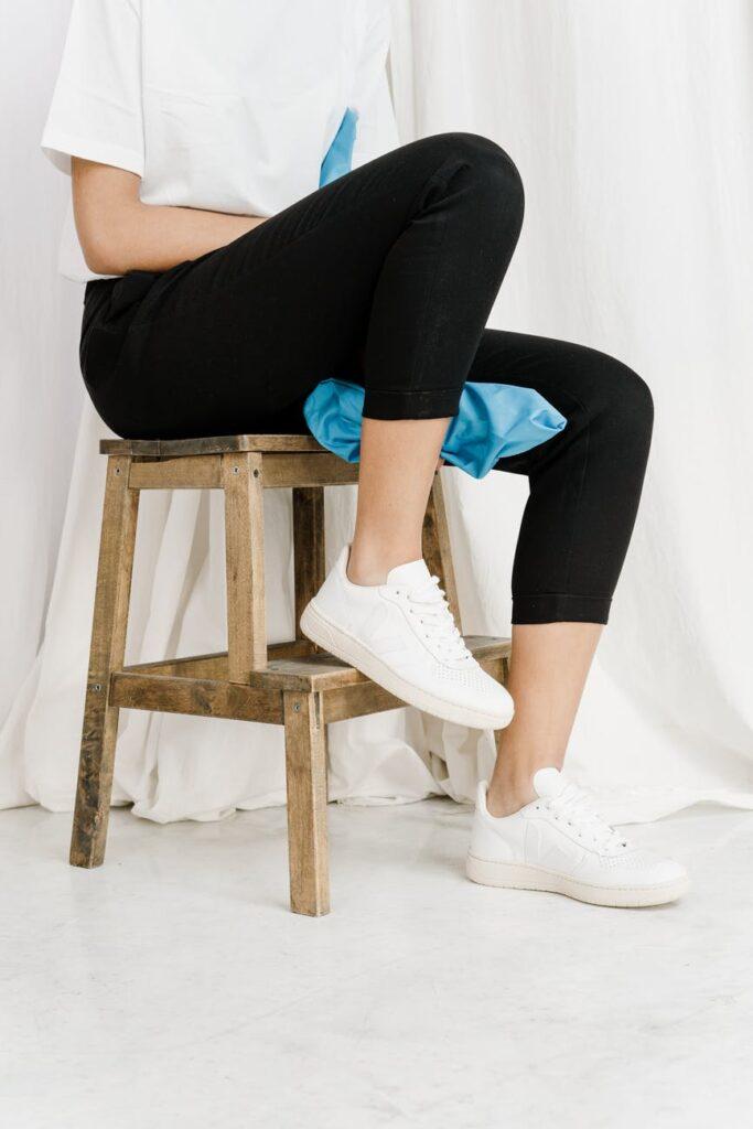 black cropped leggings on a stool