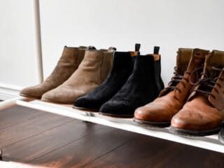 brown and black suede boots on the clothing rack