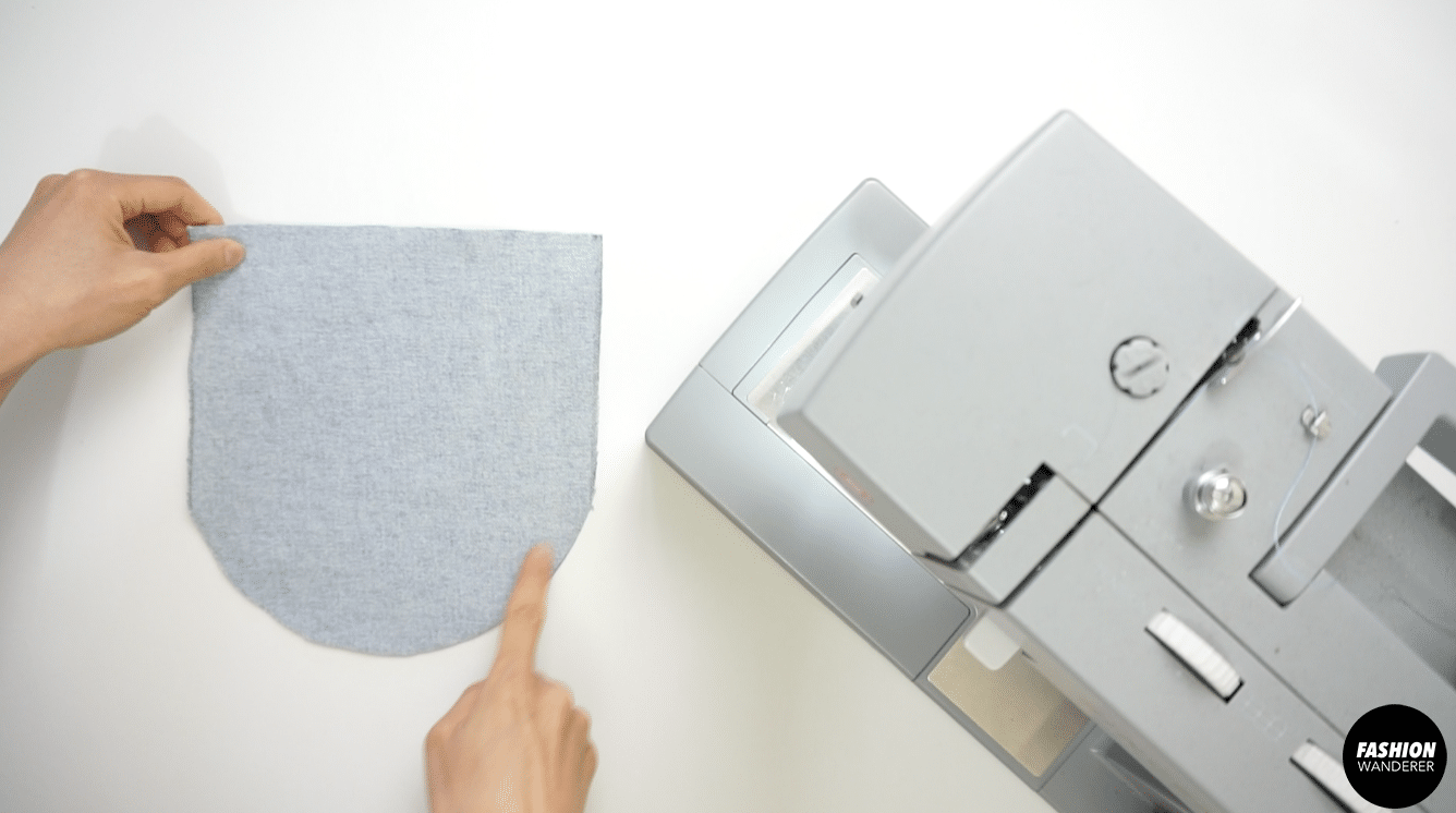 """Place right side of pocket flaps on top of each other and sew ¼"""" around the edges."""