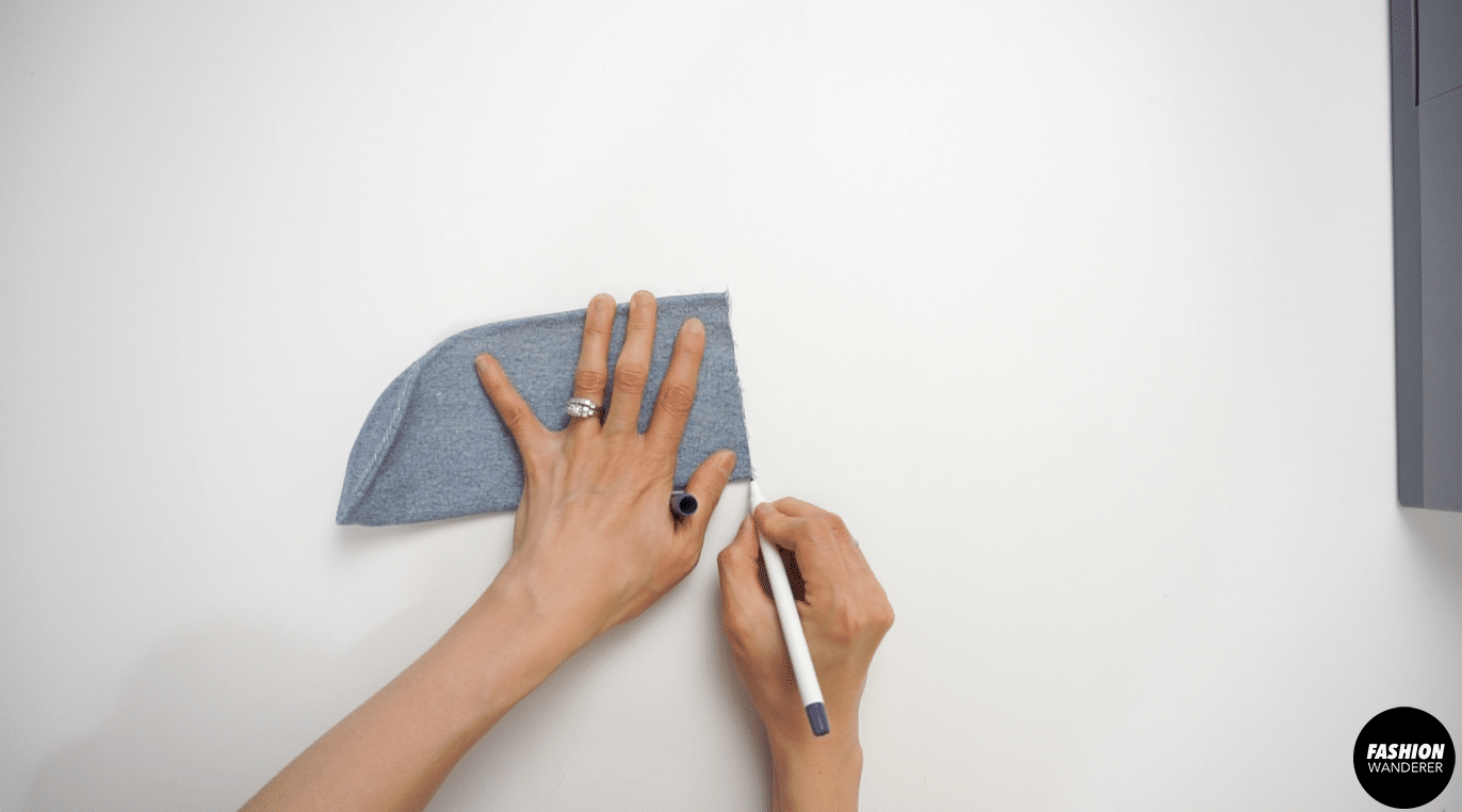 Fold the pocket flap in half and mark the half point with erasable pen.