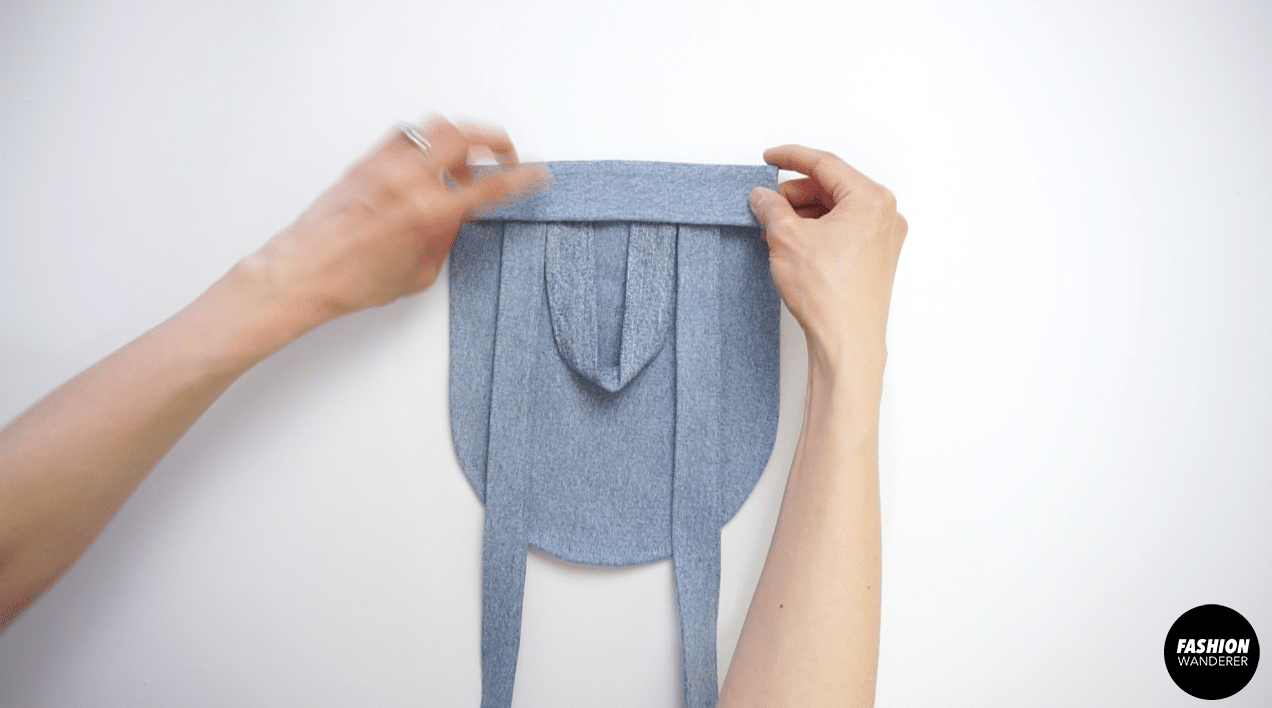 """Place the back side pieces on top of the pocket flap wrong sides on top of right side with a ⅜"""" overlap."""