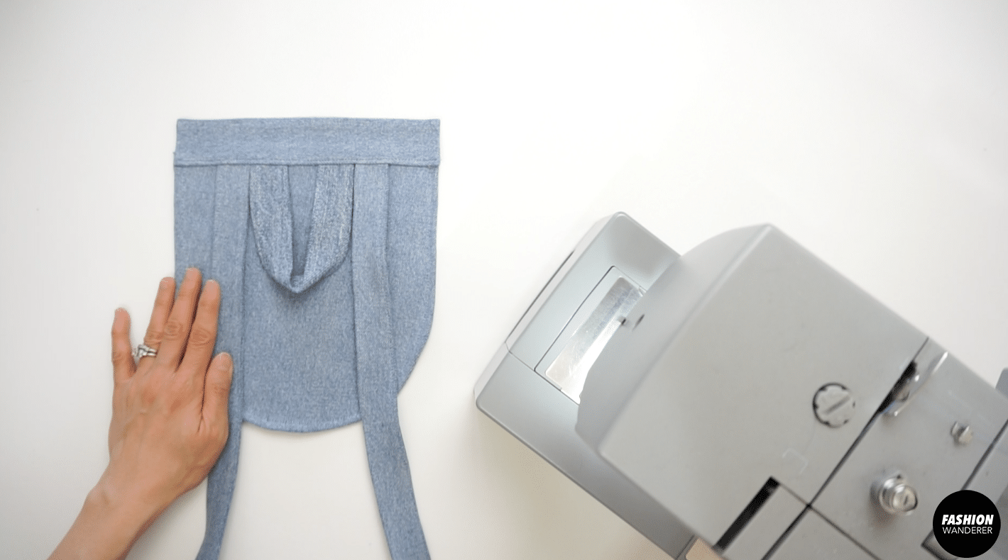 """¼"""" topstitch to secure the back piece with pocket flap."""