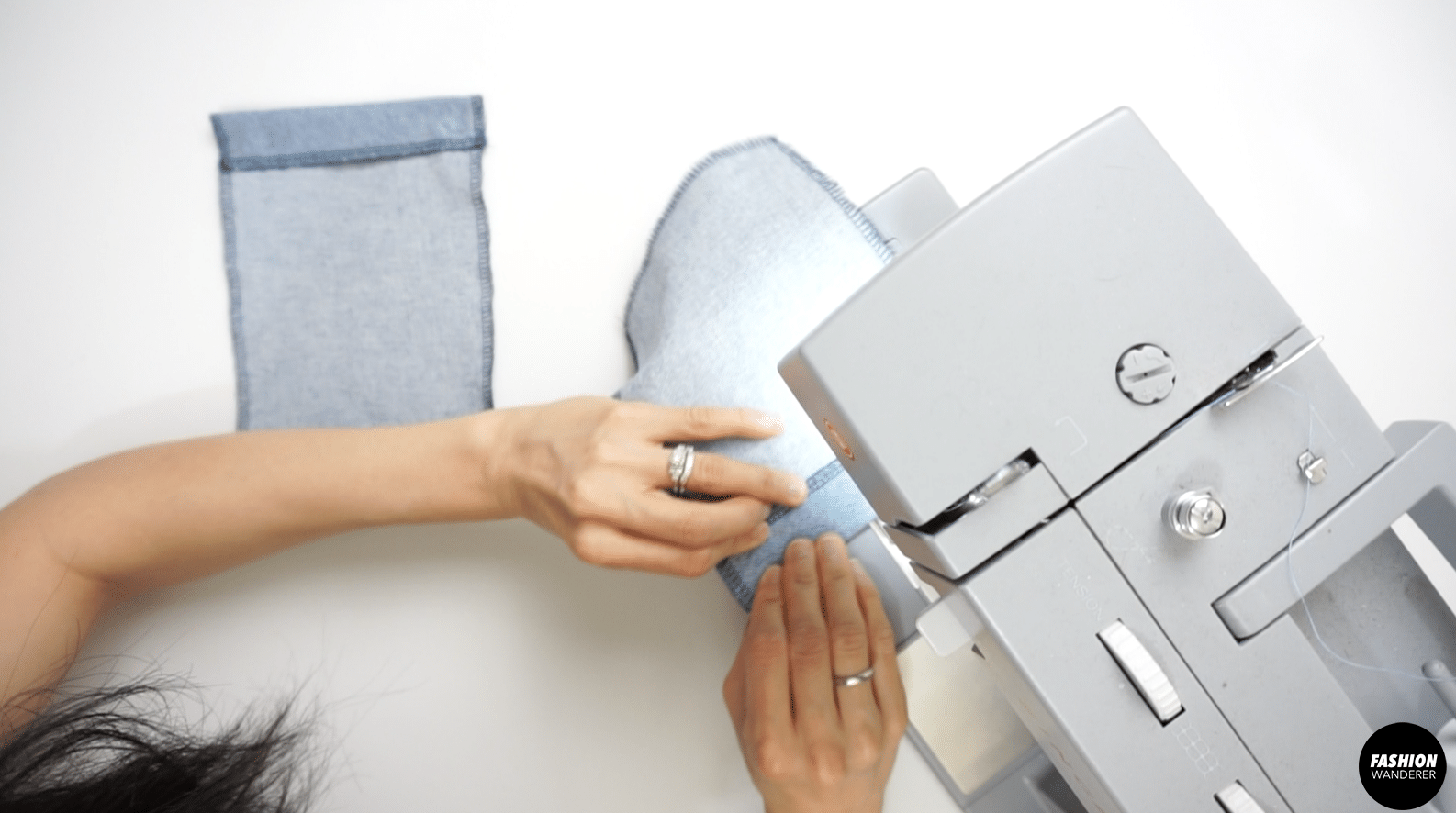 """Pin to secure and topstitch ¼"""" away from the zigzag stitch."""