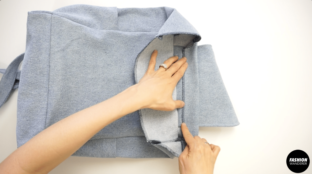 """Fold the top edges 1½"""" width and ¼"""" topstitch around."""