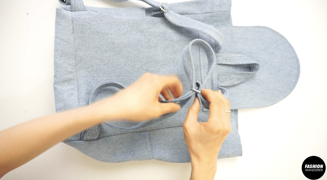 """Adjust the strap so there is 1½"""" long strap at the end."""