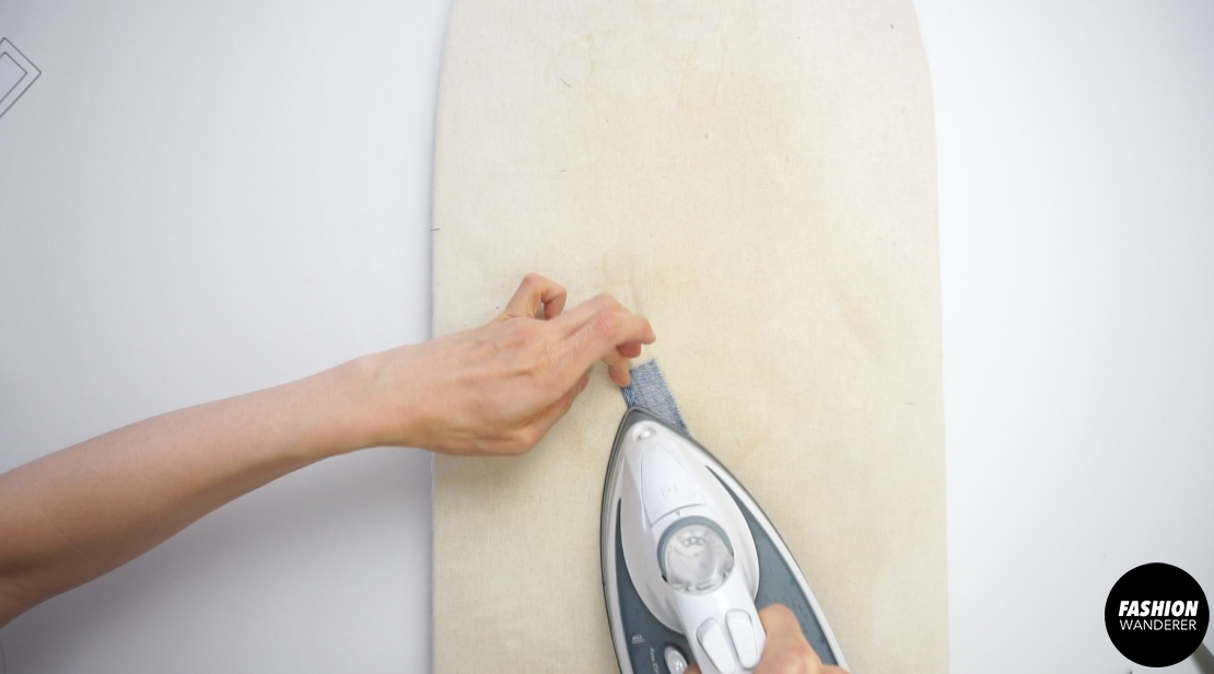 """Use ¼"""" double sided iron-on tape to fold all four sides clean."""