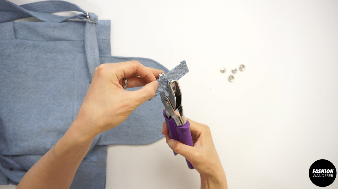 Place cap and socket on the heavy-duty plier and punch it on the marked hole.