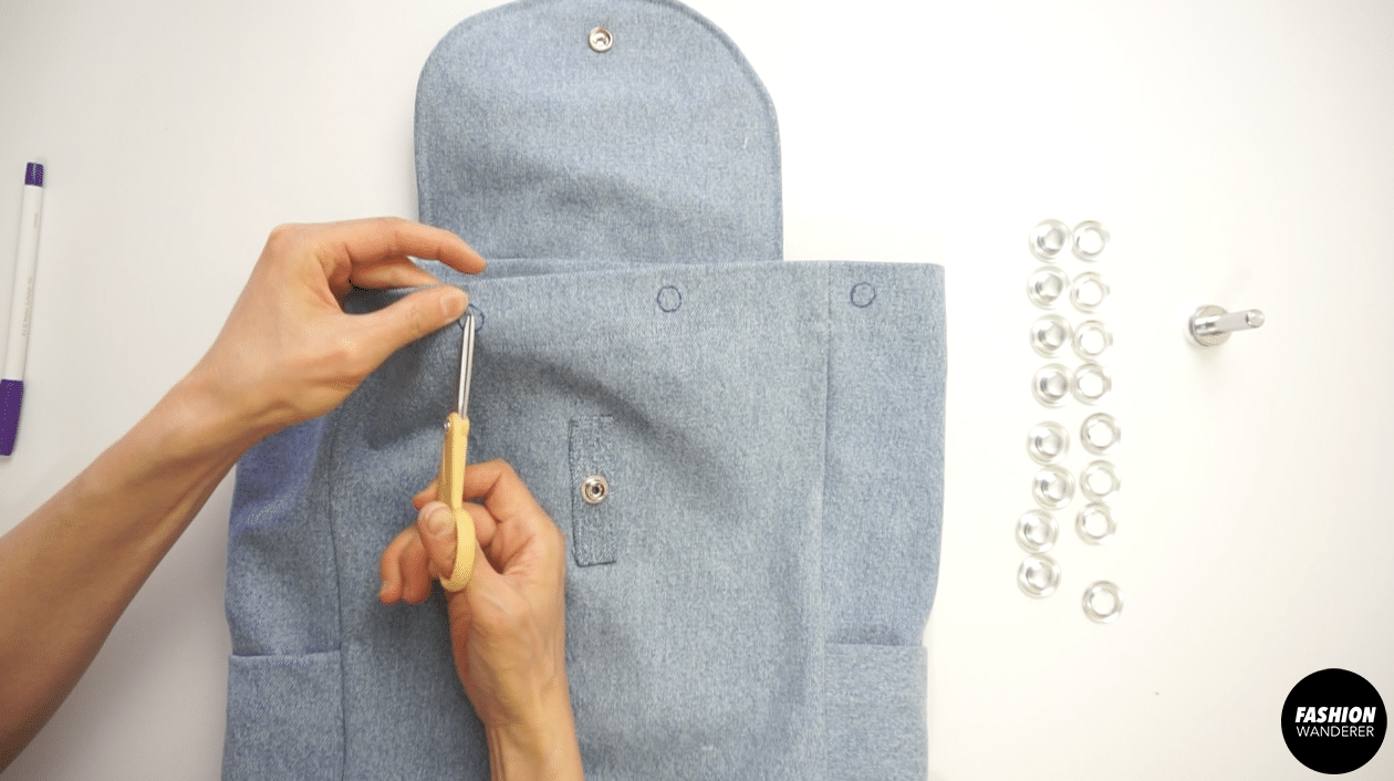 Cut out the holes and copy the holes to the back and back side of the bag.