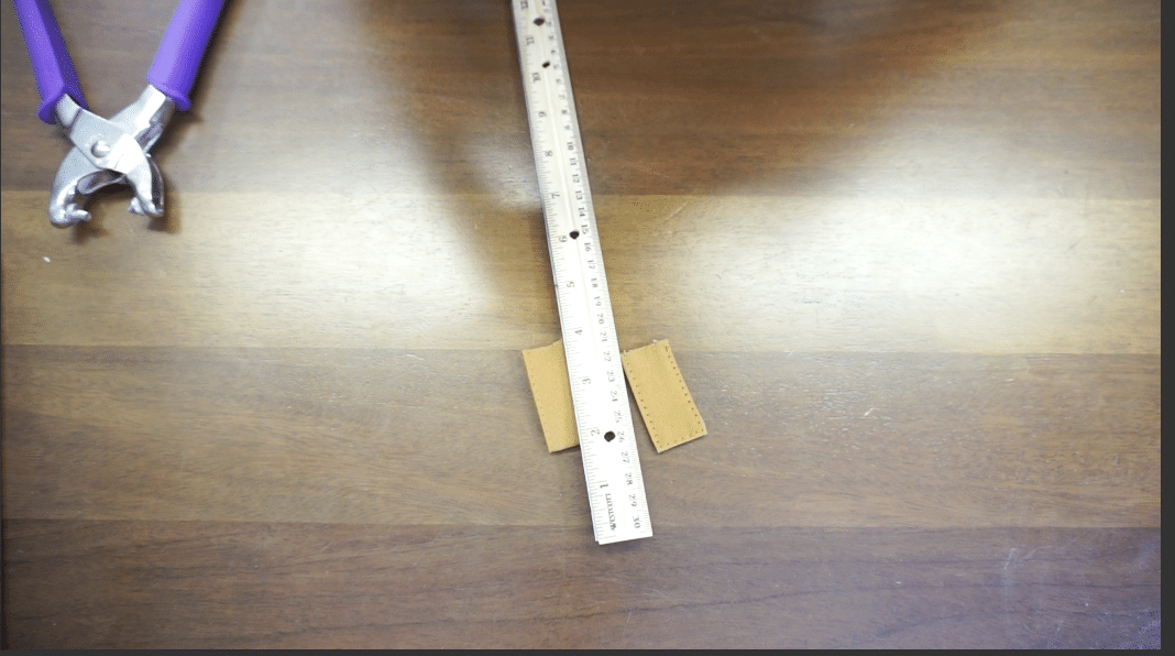 Measure half point for snap button on snap closure tab on tote bag