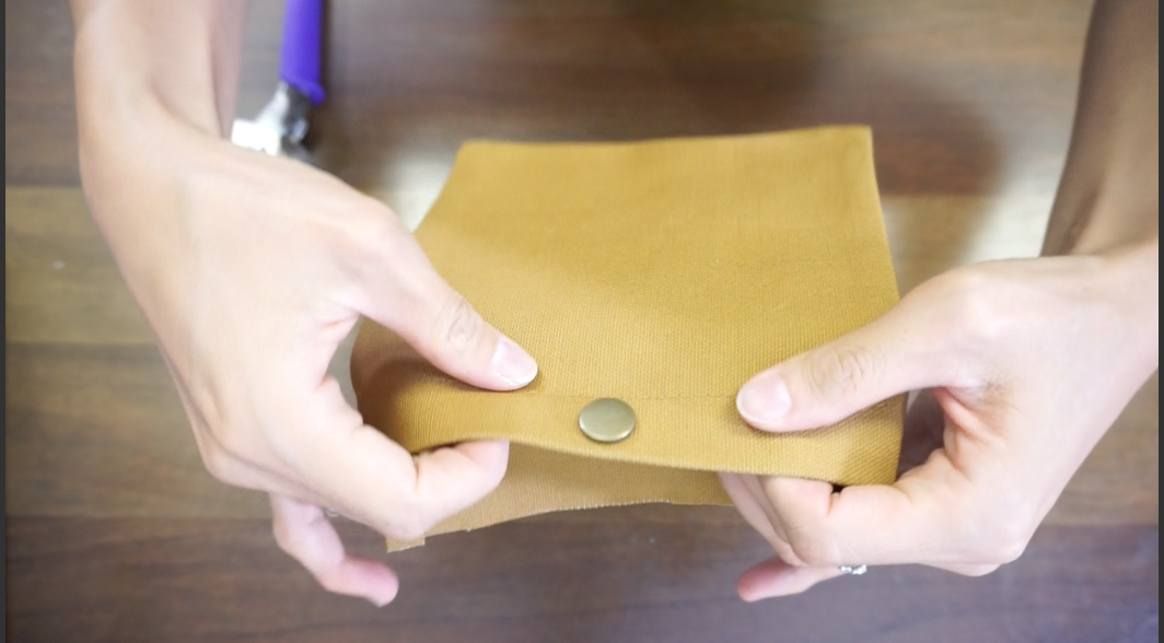 Add cap to insert snap button on the pocket