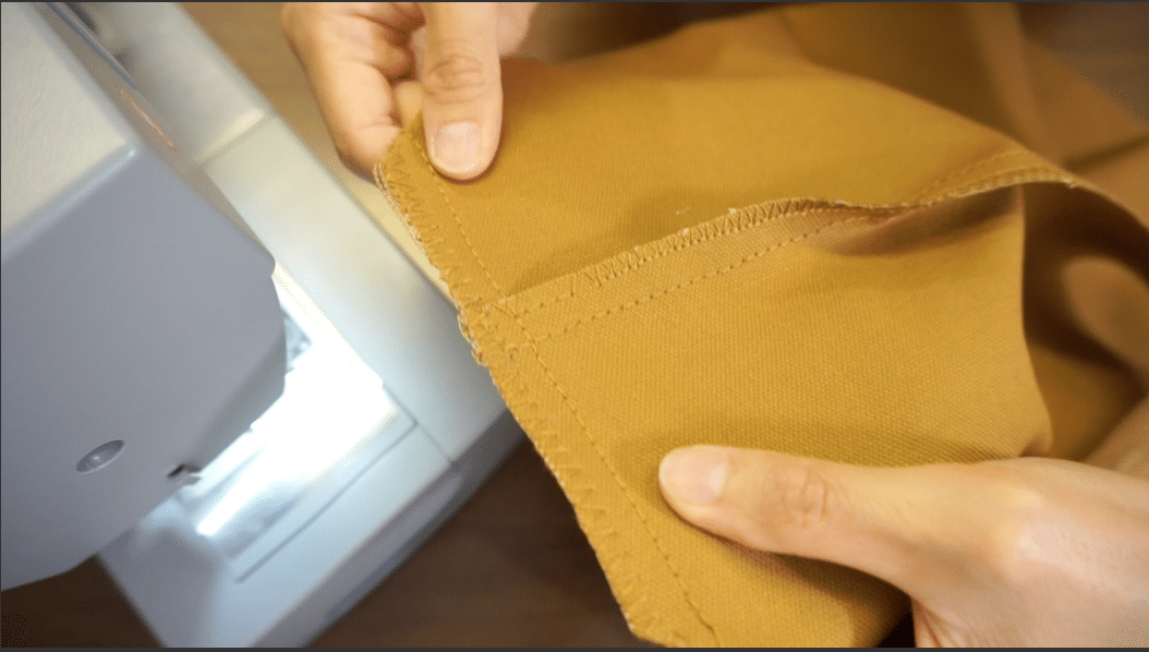 overlock and straight stitch the bottom flat of tote bag