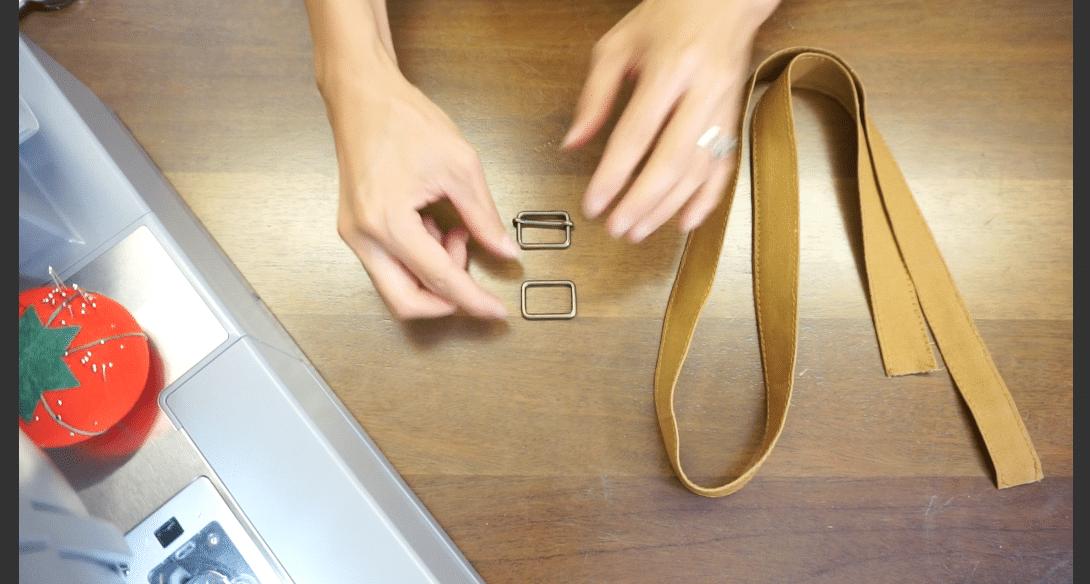 Insert rectangular shoulder hardware on the shoulder strap