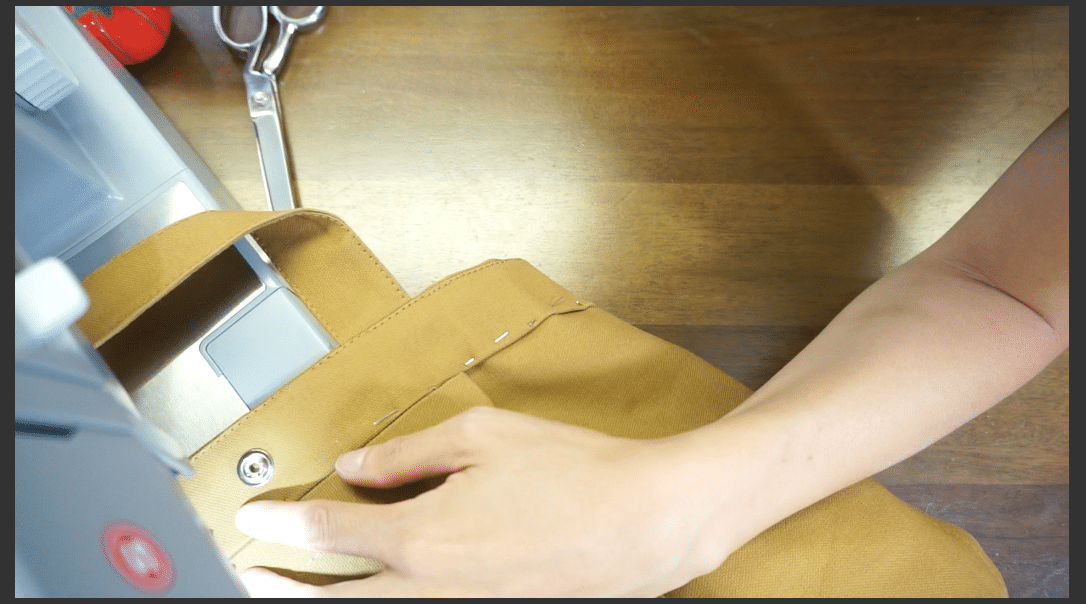 Fold over the facing and topstitch around the facing