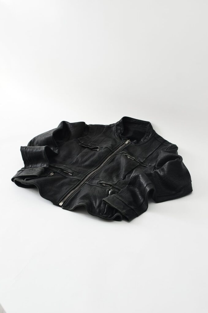 faux leather jacket laying on the ground