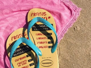 flip flop on the beach towel