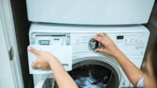putting homemade laundry detergent in the washing machine
