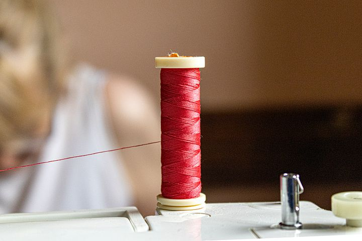 bobbin wound with red thread