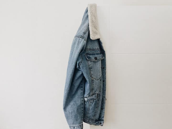 sherpa denim jacket hanging on the wall