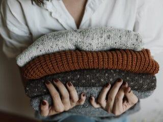 holding shrinked sweaters