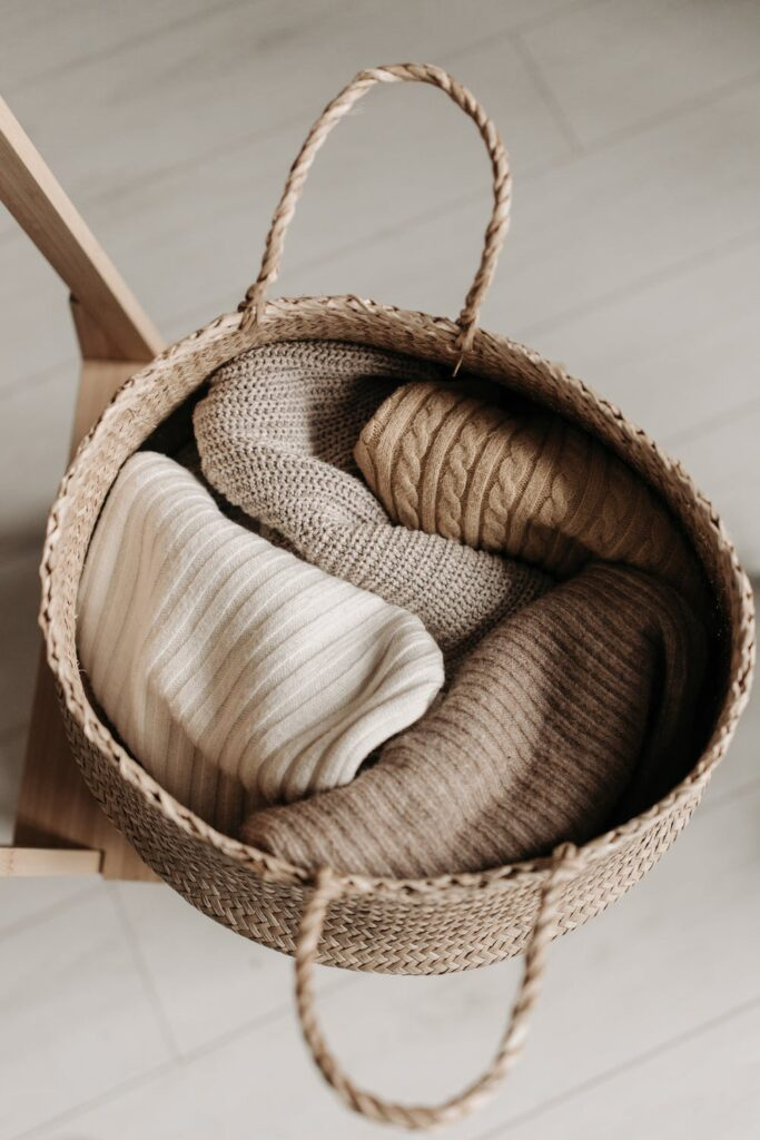 sweaters in the basket