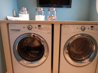 whirlpool washing machine and dryer in the room
