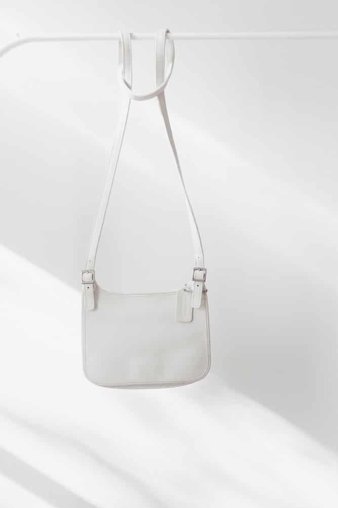 white cross body bag on the rack