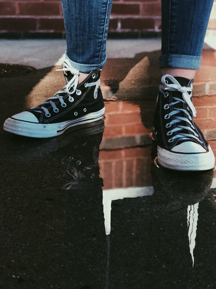 white shoe laces on black shoes
