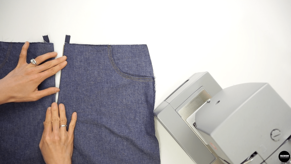 Open the zipper and fold the left side of the pants close to the zipper teeth and edge topstitch.