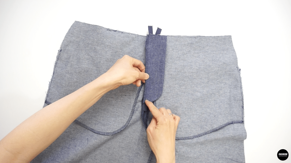 """Open the seam and place the fly piece to stitch from top to the notch with ½"""" seam allowance."""