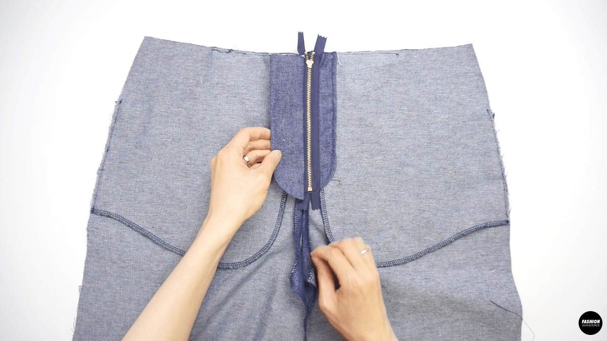 """Trim the seam allowance on fly about ¼"""" and flip to the right side and press."""