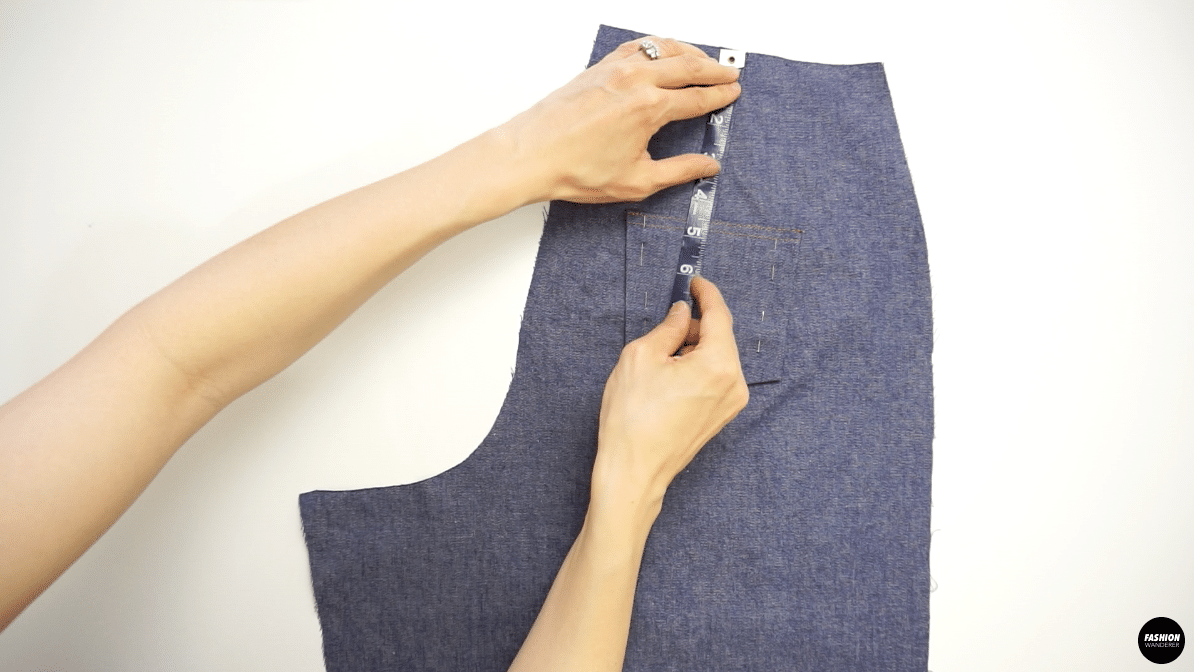 Measure placement of back pocket on back side of jeans