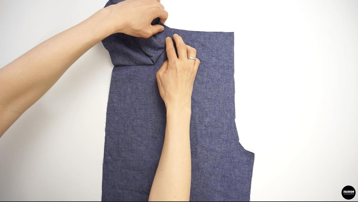 Open the seam towards the pocket facing