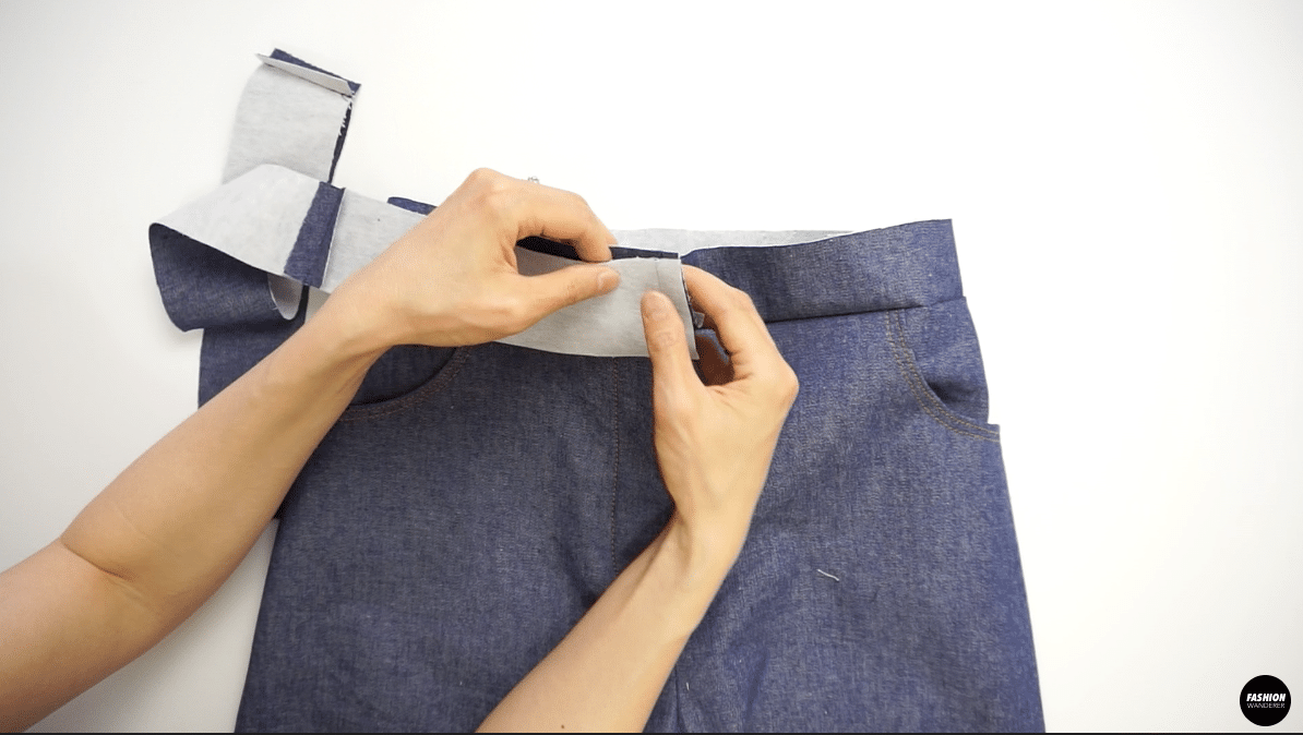 """Fold over and place the outer waistband facing each other and stitch ⅜"""" seam allowance."""