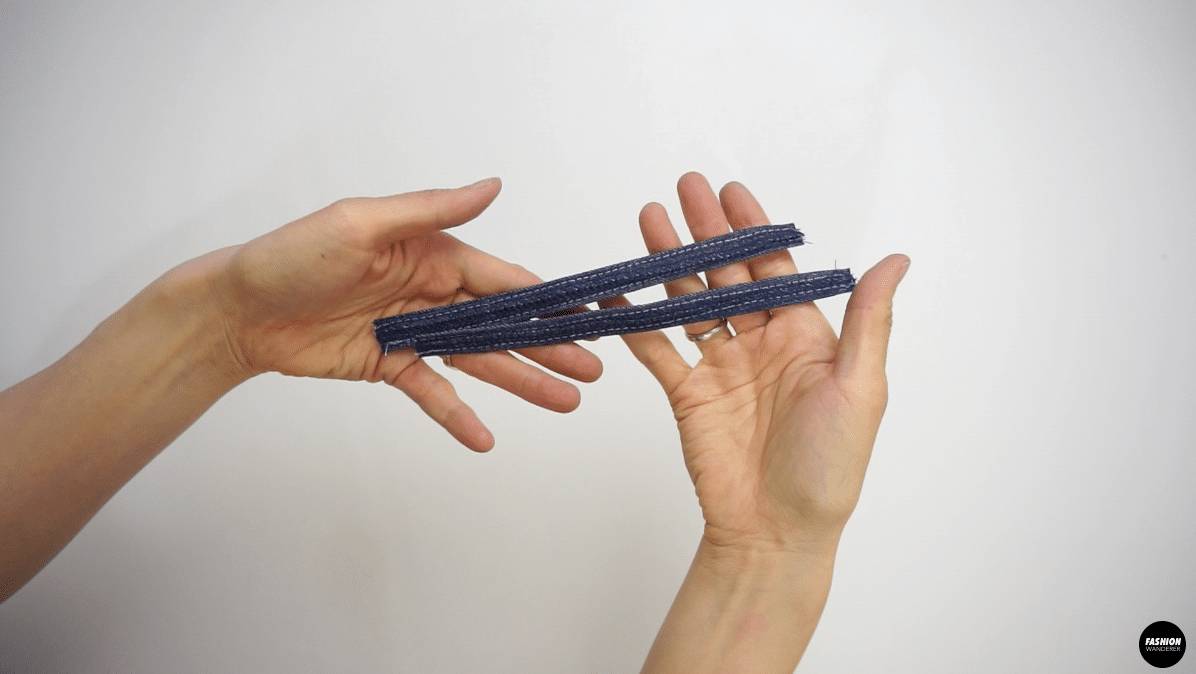 """With contrast thread, edge topstitch ⅛"""" lengthwise."""