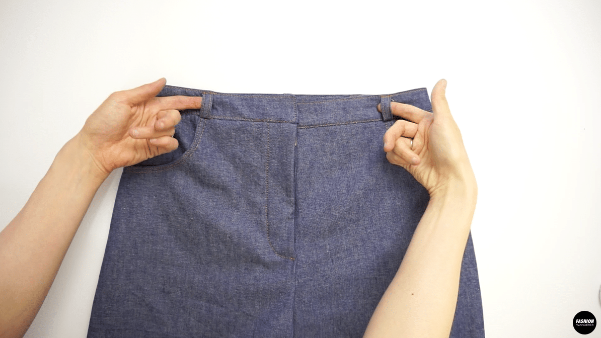 """Fold the belt loop on top and bottom to match the starting point of the pants pocket, then edge topstitch ⅛"""" to secure."""